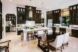 The Terrace Mediterranean Kitchen - mediterranean kitchen features dark stained cabinets paired with