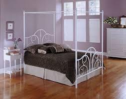 sleek white wrought iron bed frame using glazing wooden floor for