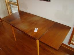 table with slide out leaves mid century modern table with slide out leaves pencil legs 31 x