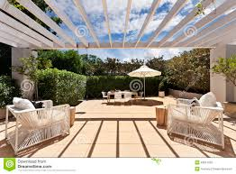 backyard cozy patio area with wicker furniture set stock photo