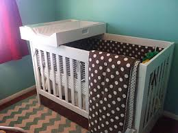 my husband made this crib changing station to fit on top of our