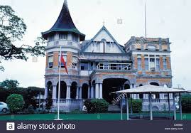 a brick victorian style house in port of spain is one of the seven
