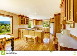 light brown kitchen cabinets white appliances and hardwood floor