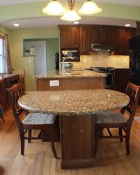 this two level island drops down to table height for easy and