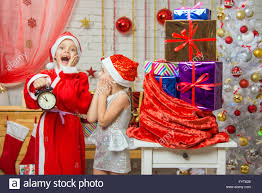 deliver presents santa and deliver presents assistant late new years stock