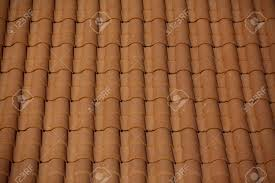 A Newly Constructed Roof With Terracotta Roof Tiles Stock Photo