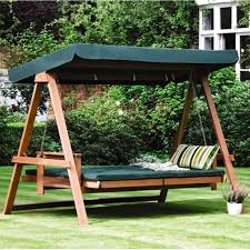 floating beds for room and garden a swinging joy this is a perfect garden day bed the green colour contrasting with the wood makes it a bed that seems to be exclusively designed for your