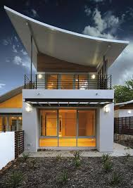 modern house with an inverted curve roof gorgeous exteriors