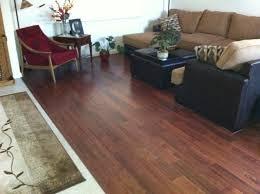 wood flooring installation downstairs w wood trim on stairs w