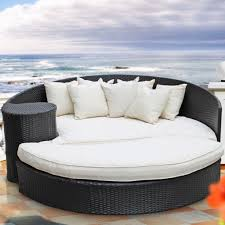 exterior stylish black wicker day bed in outdoor with white bed