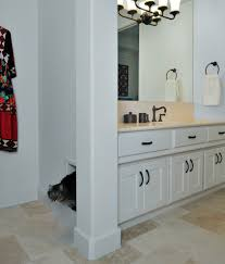 bathroom cabinet with built in laundry her litter box cabinet in bathroom mediterranean with laundry room in