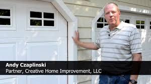 vinyl siding contractor chi offers free repair of garage door trim
