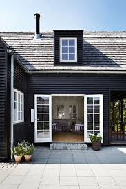 black on black house exterior with white trim charcoal to black