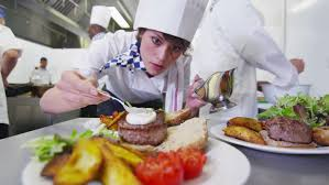 chef en cuisine delicious gourmet burger is being given the finishing touches by the