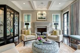 classical armchairs with big round ottoman and lovely stools