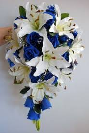 wedding flowers royal blue teardrop wedding bouquet ivory lillies royal blue roses pearl