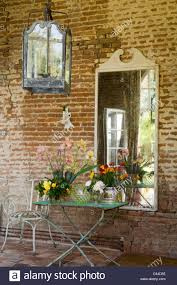 French Country House Wrought Iron Garden Furniture And Large Lantern Along Red Brick