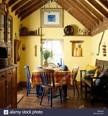 Country Dining Rooms by Blue Painted Chairs At Table With Orange Checked Cloth In Country