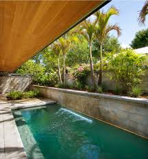 modern outdoor waterfall with backyard cabana pool contemporary