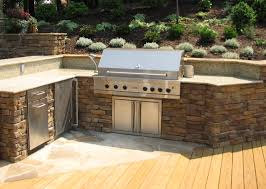 elegant outdoor kitchen designs with having stone cabinet