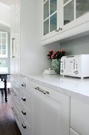 kitchen remodel using ikea cabinets counter tops are white quartz