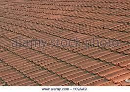 Ceramic Tile Roof with A Detail Of Ceramic Tile Roof With Brick Chimney On Old Wooden