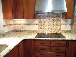 How To Install Glass Mosaic Tile Backsplash In Kitchen Diy Glass Tile Backsplash A Kitchen Kitchen Cabinets Glass Mosaic