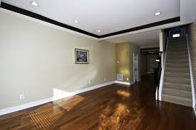 lighting cozy laminae wood flooring with white baseboard and