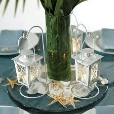 wedding reception centerpiece idea using mini table lanterns