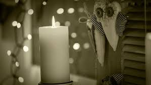 cozy windowsill with decorations and burning candle stock