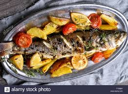 grilled fish with potato wedges top view country style stock