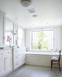 beach house bathroom traditional with white wainscoting honed