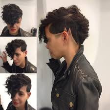 fades and shave hairstyle for women women s chic wavy faux hawk with shaved line art and fade short