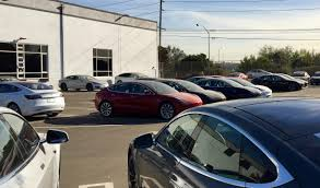 tesla opens new los angeles delivery center with lot full of model