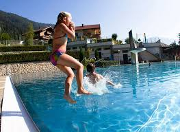 Outdoor Swimming Pool by Book Your Active Holiday In Summer In Tux Finkenberg