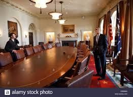 The Cabinet Members Us President Barack Obama Surveys The Cabinet Room With Family