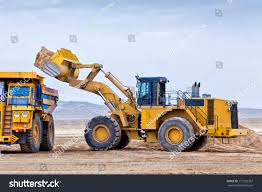 wheel frontend loader unloading ore into stock photo 117232357
