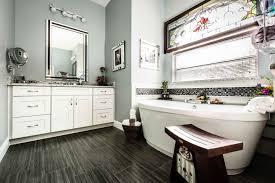 Showcase Your Space Waypoint Living Spaces - White cabinets dark floor bathroom