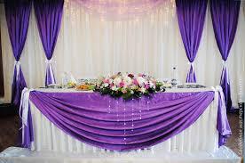 wedding backdrop linen drape coloured linen in front of table dekoracja domu