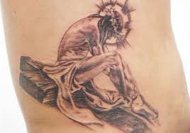 jesusand religous tattoos of this is