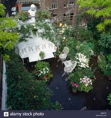 birdseye view of secluded roof garden with white metal furniture