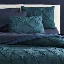 bedrooms modern dark blue bed linens and dark blue pillows