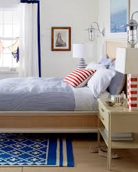 bright white beach bungalow bedroom with pops of red cobalt blue