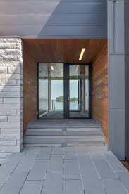 modern house entrance glass lake house features modern silhouette of earthy materials