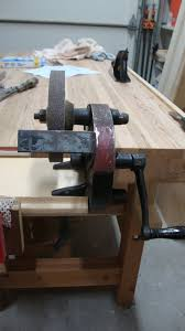 woodworking in a tiny shop cleaning up an old hand crank grinder