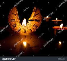 halloween pumpkin head jack lantern with burning candles over black background ruined candle clock passing time candle stock photo 271163006
