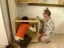 what height to hang cabinets how to install wall and base kitchen cabinets how tos diy