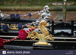 ornamental sea horses as decoration on venetian gondolas stock