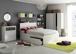 Woman Standing In A Bedroom With Ikea Bed Armchair Mirror Drawers - Modern ikea small bedroom designs ideas
