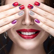 beautiful with a bright evening make up and manicure with